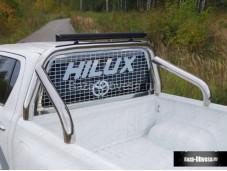 """Защитная дуга 76,1 мм в кузов с дополнительной светодиодной оптикой и защитной сеткой заднего стекла """"TCC"""" Россия на Toyota Hilux с 2015г. выпуска"""
