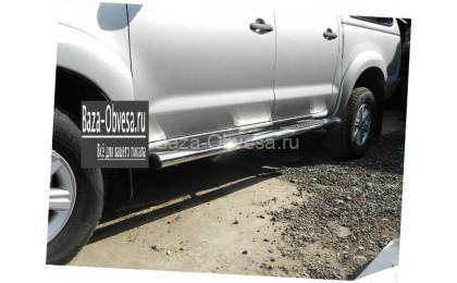 Пороги овальные стальные для Toyota Hilux до 2014г. выпуска